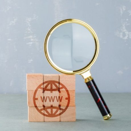 conceptual-internet-search-with-wooden-blocks-with-internet-icon-magnifying-glass-side-view_176474-10520